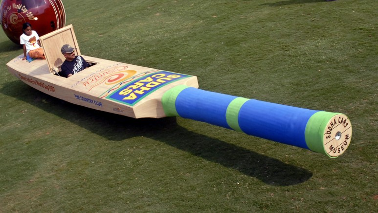 A man rides cricket bat shaped car in Hyderabad